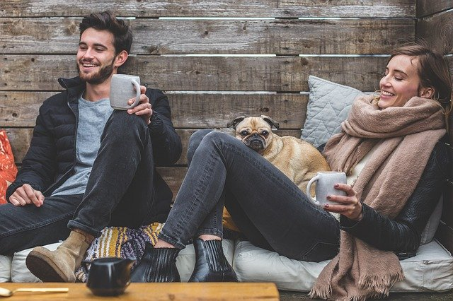 People relaxing with pug